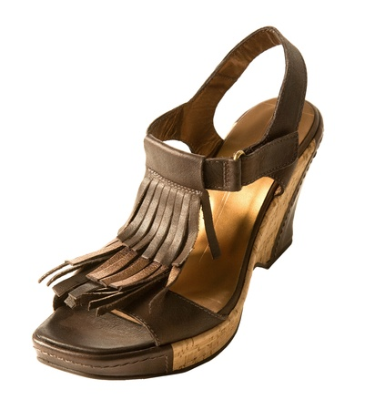 heel strap: Wedge fringed brown leather sandal, isolated on white. Clipping path included. Stock Photo