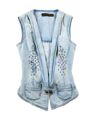 Worn stained studded denim vest isolated on white background photo