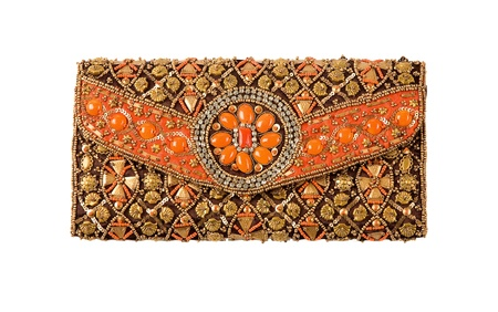 Ethnic ornaments handbag isolated on white background. Clipping path included.