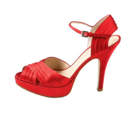 Red leather peep toe stilettos isolated on white background. Clipping path included. Stock Photo