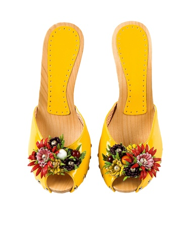Wooden wedge yellow patent leather artisan fruits and flowers sandals isolated on white background  Clipping path included  photo