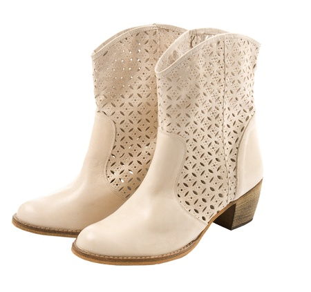 western attire: White perforated leather cowgirl boots pair, isolated on white background  Clipping path included  Stock Photo