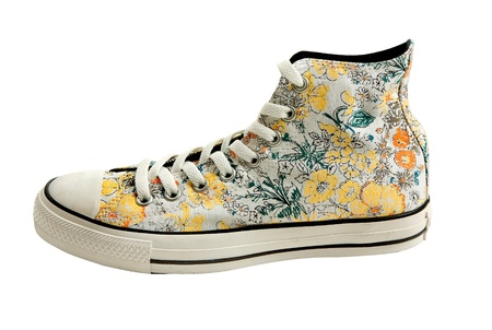 Flowers print white sneaker bootie isolated on white background. Clipping path included. photo