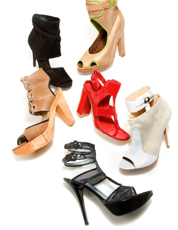 ankle strap: Peep toe booties stilettos fashion still life composition on white background