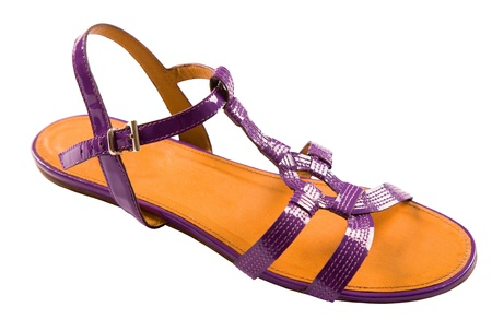 ankle strap: Purple patent leather flat sandal isolated on white background. Clipping path included Stock Photo