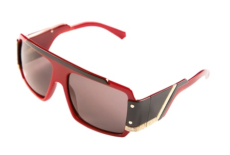 Rimmed red black and golden sunglasses isolated on white background. Clipping path included photo