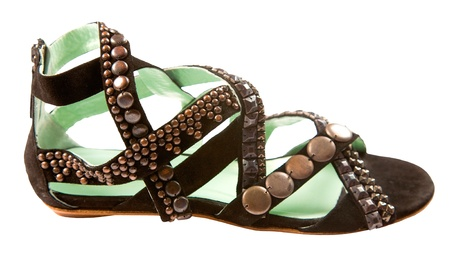 Studded leather roman sandal isolated on white background. Clipping path included.