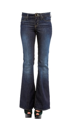 peep toe: Young woman legs in bell bottom jeans and platform peep toe stilettos isolated on white background  Clipping path included