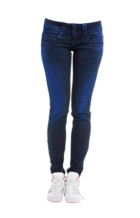 Young woman legs with dyed blue jeans and sneakers isolated on white background  Clipping path included