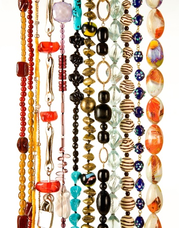 Beaded necklaces fashion composition on white background photo