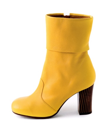 Elegant yellow leather boot with wooden heel isolated on white background  Clipping path included Stock Photo - 18608318