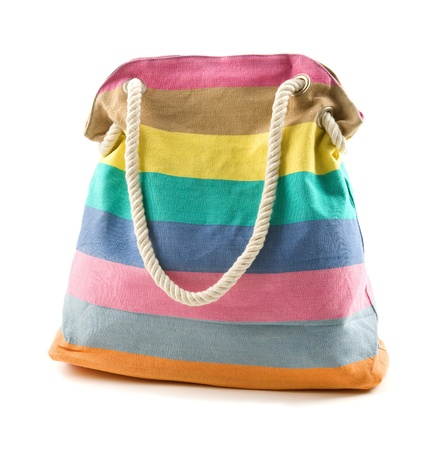 Canvas multicolored striped beach bag with rope shoulder strap isolated on white background  photo