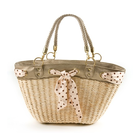 Polka dots vintage belt and leather basket tote isolated on white background  photo