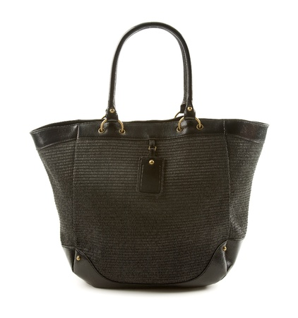 tote: Raffia and black leather basket tote isolated on white background  Stock Photo
