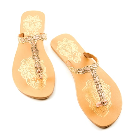 Golden birds and strass flip flop sandals isolated on white background
