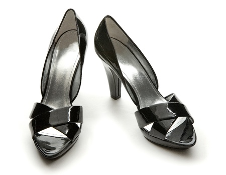 peep toe: Black patent leather elegant peep toe pumps isolated on white background. Stock Photo