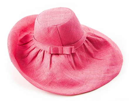 Bow tie strap pink raffia floppy hat isolated on white background. photo