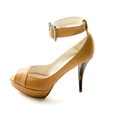 peep toe: Elegant ankle strap nude peep toe bone stiletto isolated on white background. Clipping path included.