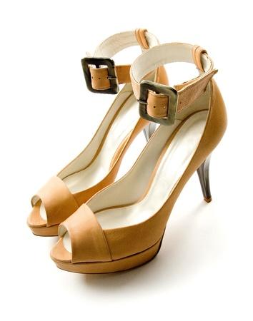 heel strap: Elegant ankle strap nude peep toe bone stilettos pair isolated on white background. Stock Photo