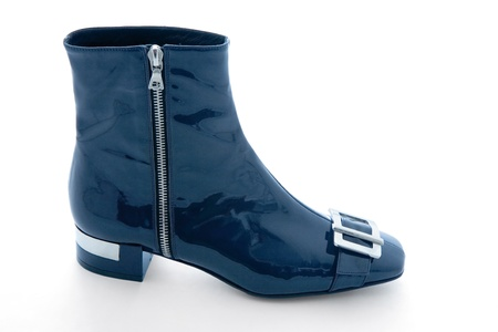 zipped: Navy blue patent leather zipped bootie isolated on white background.