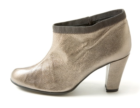 heeled: Silver leather high heeled bootie isolated on white background.
