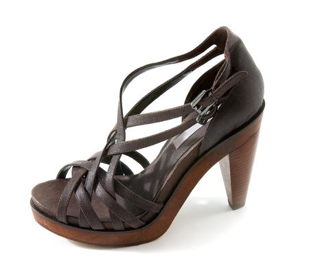 peep toe: Wooden high heeled brown leather sandal isolated on white background.