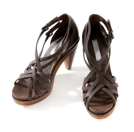 peep toe: Wooden high heeled brown leather sandals pair isolated on white background Stock Photo
