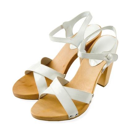 peep toe: Wooden soled white leather high heeled elegant sandals isolated on white background. Stock Photo