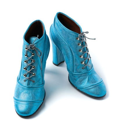 Sky blue metallized leather high heels booties isolated on white background  photo