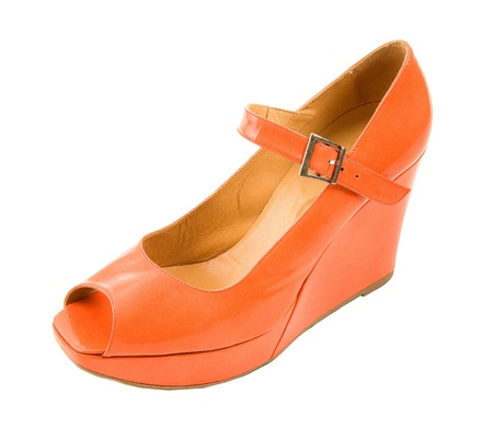 Tangerine patent leather wedged peep toe high heel isolated on white background    photo
