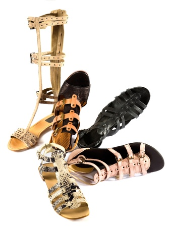Roman sandals still life fashion composition isolated on white background  photo
