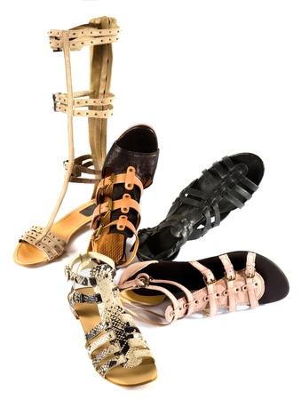suede belt: Sandalias romanas Todav�a composici�n de la vida de manera aislada en el fondo blanco