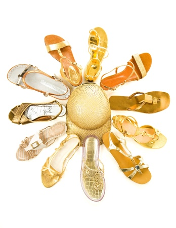 Sun shaped golden sandals still life fashion composition isolated on white background  Stock Photo - 18803918