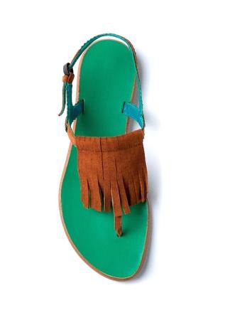 Fringed suede flip flop sandal isolated on white background  photo
