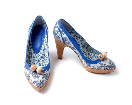 Porcelain like flowers pattern raffia platform wooden beads high heels isolated on white background  photo