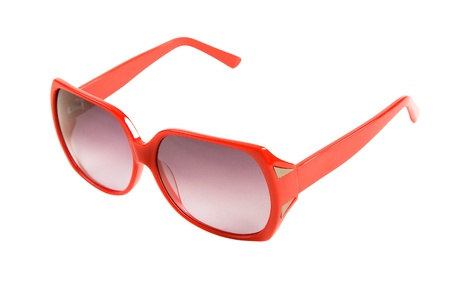 Red rimmed sunglasses with mirror ornaments isolated on white background  Clipping path included Stock Photo - 18960150