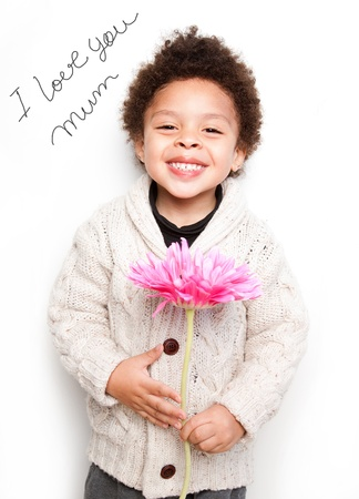 Child with big smile and big pink flower with I love mum message isolated on white background photo