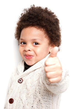Cute child doing thumbs up sign isolated on white background  photo
