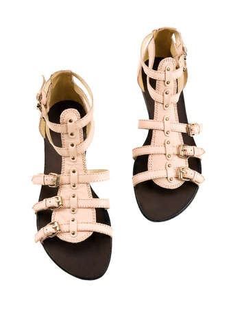 wearing sandals: Light pink leather ankle boot roman sandals isolated on white background  Clipping path included