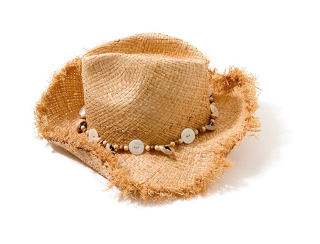 Raffia fringed farmer hat with beads and buttons hatband isolated on white background