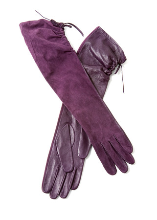 Long elegant leather and suede purple gloves isolated on white background. Stock Photo