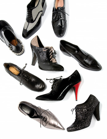 Black masculine female shoes still life fashion composition on white photo