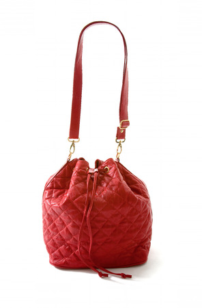Red leather padded purse isolated on white