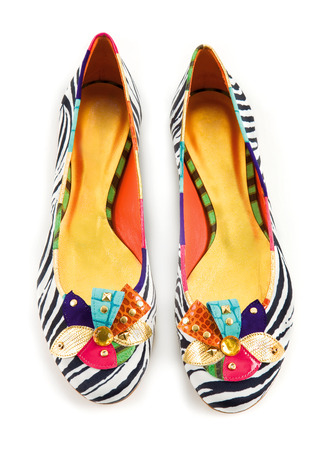 Zebra pattern ornate ballerinas on white photo