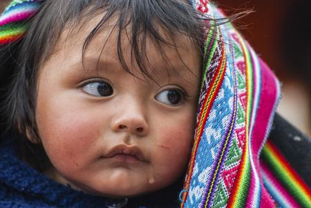 MOB, PERU - AUGUST 15, 2011 - An unidentified Peruvian child in Mob, Peru during a religious celebration