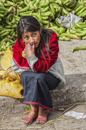 Guamote, Ecuador - August 11, 2016: Unidentified girl at Guamote Ecuadorian Market. Famous Guamote market, attracts Thousands of tourists