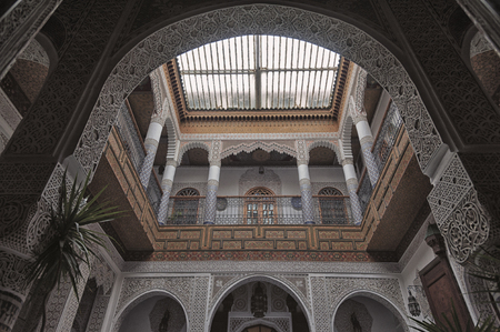 family owned: FEZ, MOROCCO - FEBRUARY 19, 2017: Interior of a small family owned hotel in the medina of Fes. The medina is listed as a UNESCO World Heritage Site