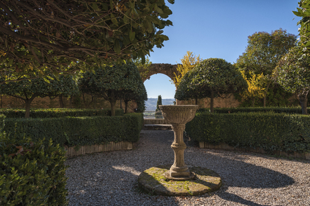 PIENZA - TUSCANY / ITALY, OCTOBER 30, 2016: The beautiful Italian Renaissance garden with the Italian Garden of Piccolomini Palace, one of the first examples of Renaissance architecture in Pienza, Val D'Orcia - Tuscany Italy Banco de Imagens - 79533569