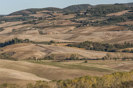 unesco: VAL DORCIA, TUSCANY-ITALY, OCTOBER 30, 2016: Scenic Tuscany landscape with rolling hills and valleys in Val DOrcia, Italy