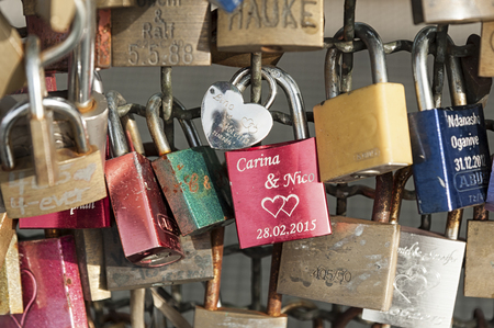 COLOGNE, GERMANY - SEPTEMBER 11, 2016: Hohenzollern railway Bridge in Cologne or famous Colognes Love Locks Bridge with thousands of padlocks left by lovers. Locks with engraved and written inscriptions and names. germany